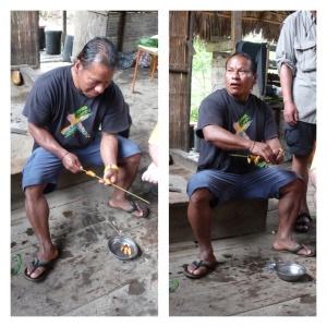 Tyson preparing some palmwood worm kebabs